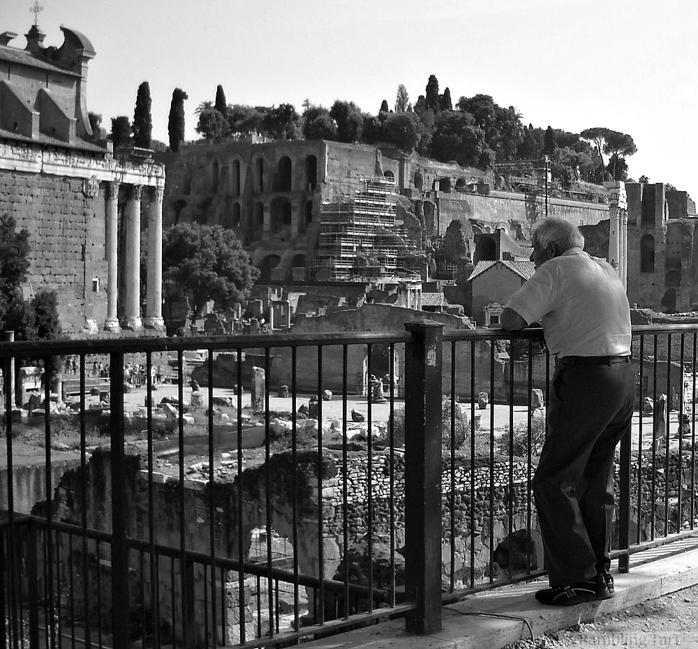 old man at Roman ruins
