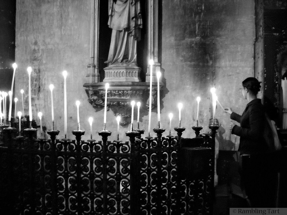 lighting candles in Paris