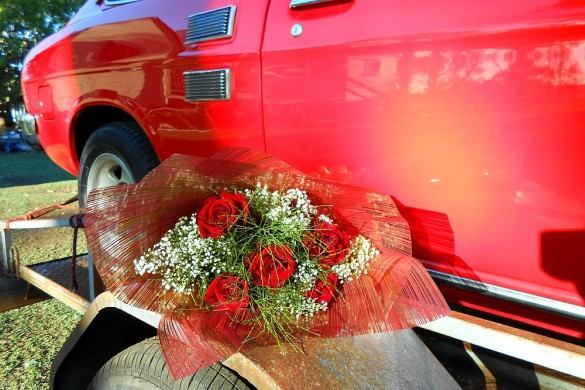 roses next to red car