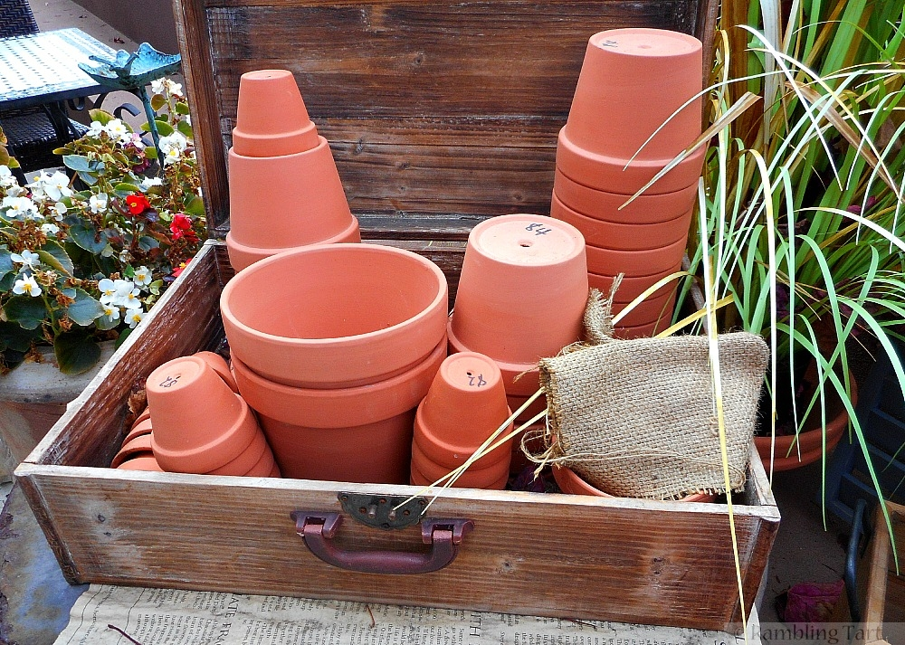 wooden box of clay pots