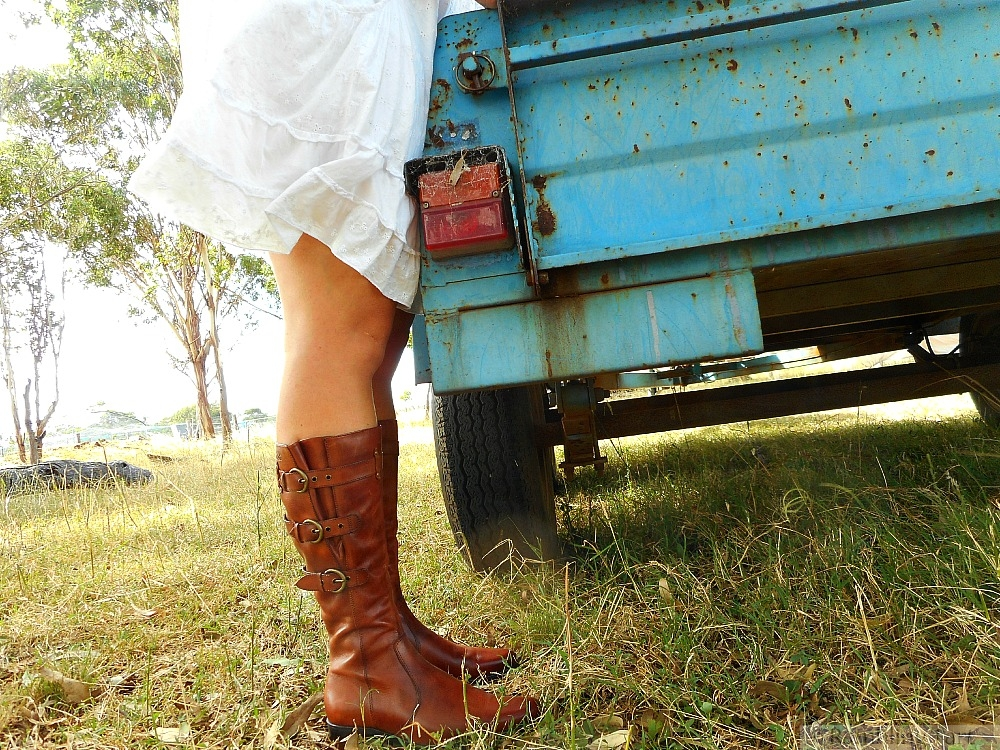 girl in sundress and boots