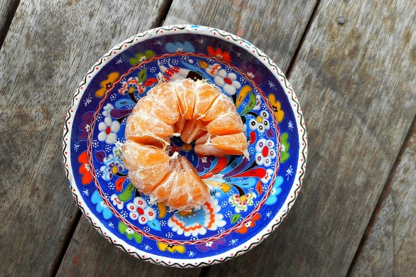 mandarin orange in blue bowl