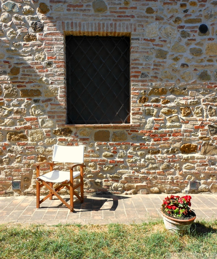 chair by stone wall