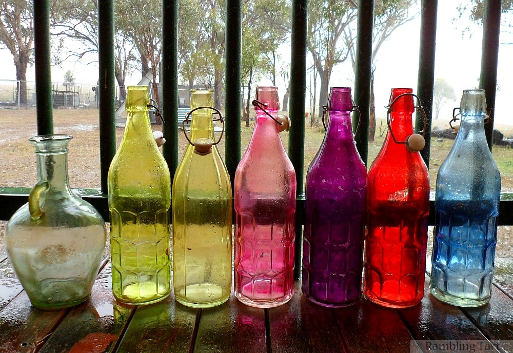 colored bottles in the rain