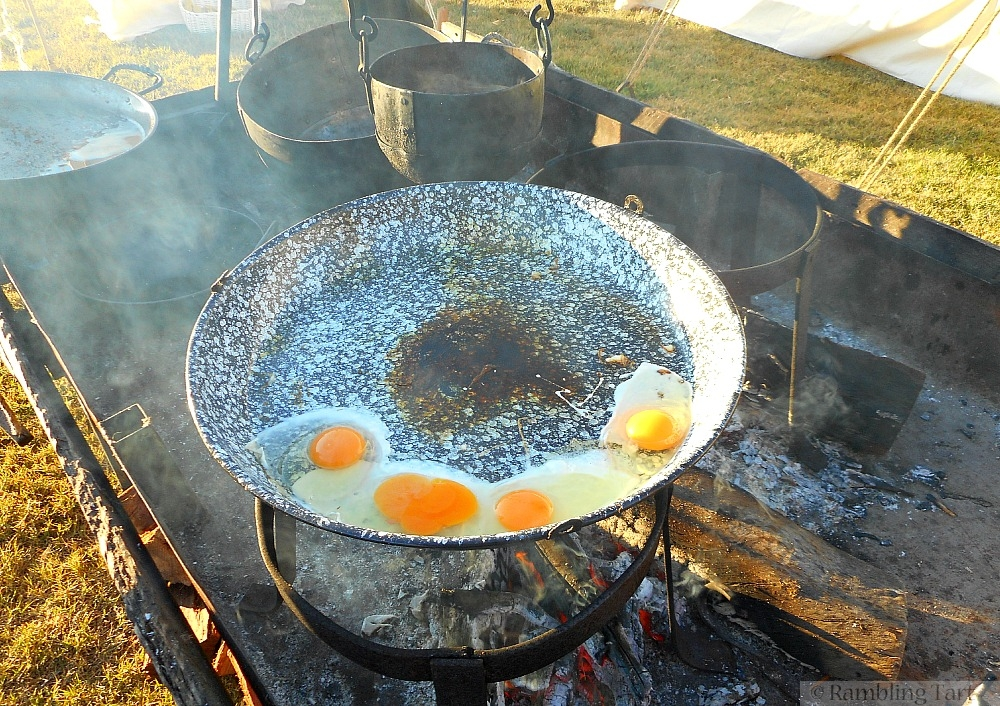 frying eggs over fire