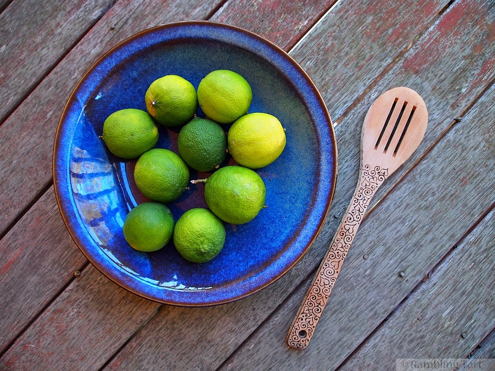 limes in blue bowl