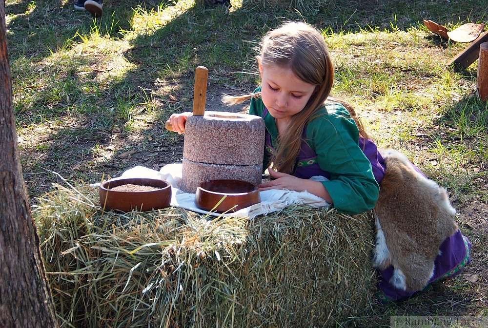 viking girl with grinding stone